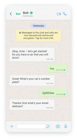 Mobile phone showing WhatsApp exchange between chatbot and driver
